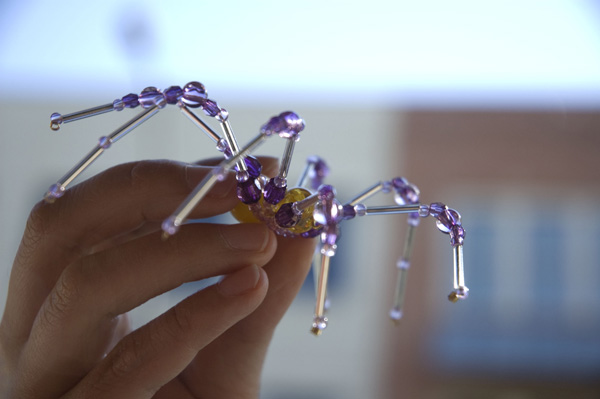 Beaded spiders catch the light when you hang them in windows.