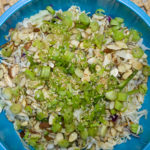Ramen, slaw, jalapeno, almonds, scallions, sesame seeds, and dressing