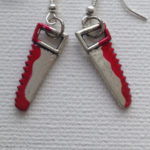 Bloody saw earrings by Mogglepops
