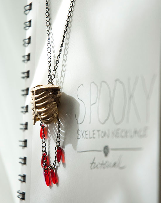 Make this cool Halloween necklace out of stuff from the dollar store.