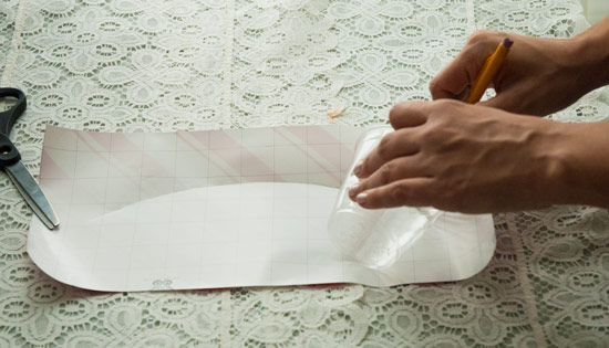 Trace the cup onto the paper as you roll it on its side.