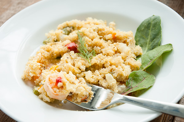 Quinoa baked with shrimp, vegetables, and cheese.